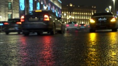 Yellow taxi passes by. Car Lights Reflect on Rainy Road and at Night City Stock Footage
