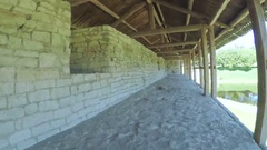 Wooden carport on castle wall Stock Footage