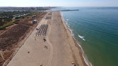 Flight filming over the beach Falesia overlooks the breakwaters, docks marina Stock Footage