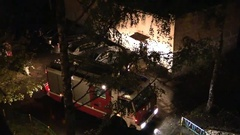 Fire engine in the yard of urban high-rise building Stock Footage