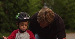Medium shot of a boy's first time riding a bike. Stock Footage