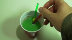 Mixing paint brush mix Stock Footage