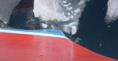 Prow Ship breaks ice in the sea of Spitsbergen Norway Stock Footage