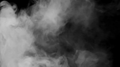White cloud smoke / ink on water on black background Stock Footage