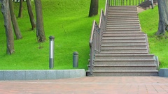 Asian girl running down stairs at park. Fitness model running downstairs Stock Footage