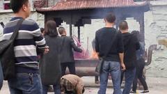 People praying,  tayun mountains in autumn Stock Footage