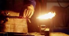 Welder holding welding torch Stock Footage