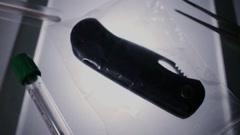 CSI Forensic examination knife Stock Footage