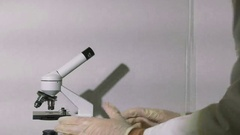 Scientist looking through microscope study science Stock Footage