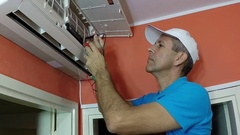 Engineer Testing Air Conditioner With Digital Measuring Instrument Stock Footage