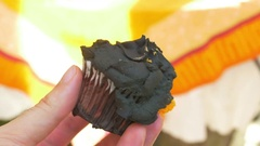 Suspicous weird rotten cupcake rotted food Stock Footage