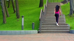 Young woman walking up stairs. Sporty girl climbing stairs Stock Footage