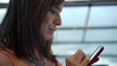 Young woman with smartphone drinking cocktail sitting in cafe, 4K Stock Footage