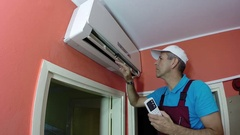 Engineer Examining Air Conditioning System Stock Footage