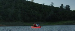 Men canoeing in lake on a sunny day Stock Footage