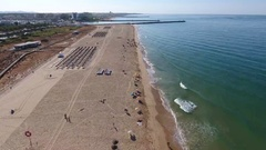 Flight filming over the beach Falesia and relaxation area Stock Footage