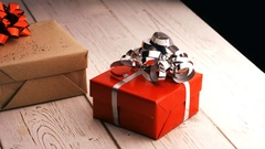 Close-up of wrapped gift box on wooden table Stock Footage
