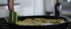 Person preparing an omelette in the frying pan Stock Footage