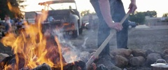 Person collecting charcoal for the grill Stock Footage