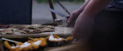 Man preparing a meal at campsite Stock Footage