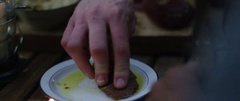 Person dipping bread in olive oil Stock Footage