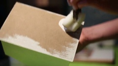 Artist paints a casket in white color 1 Stock Footage