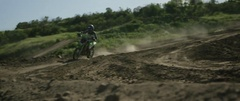 Motocross racers racing on the road track Stock Footage