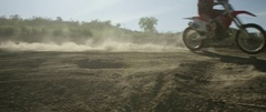 Motocross racer racing on road track in slow motion Stock Footage