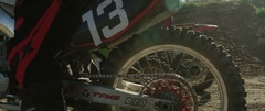 Motocross racer on bike preparing for race on a sunny day Stock Footage