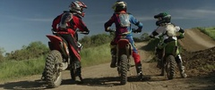 Motocross racers on bike preparing for race on a sunny day Stock Footage