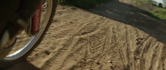 Motorcycle wheel moving on the road track in slow motion Stock Footage