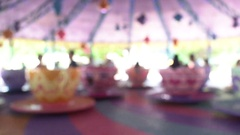 Motion blur of plaything big cup in the amusement park Stock Footage
