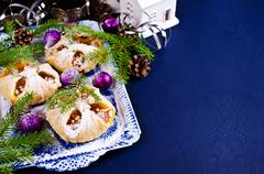 Puff with jam, sprinkled with powdered sugar, on the background of Christmas Stock Photos