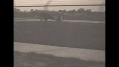 Vintage 16mm film, 1930, Dearborn Ford airport hangars. POV drive by Stock Footage