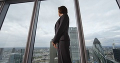 4k, Portrait of a confident mature businesswoman standing in an office Stock Footage