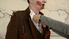 Bride woman zombie are correcting his tie Stock Footage