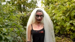 Bride zombie are walking in park Stock Footage