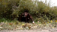 Bloody zombie crawling on the ground Stock Footage