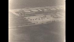 Vintage 16mm film, aerial Curtiss hangars and landing POV Arkistovideo