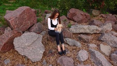 Trendy white collar woman escape from office, sit and play with soft toy Stock Footage