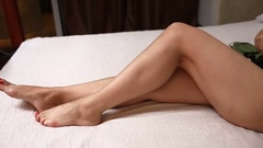 Sexy woman in lingerie is lying in bed with a rose Stock Footage