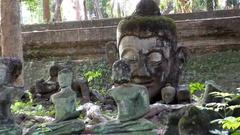 Very old Buddha figures broken Stock Footage