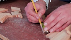 Close up view of a man's hands measuring wooden plank with tape line Stock Footage