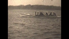 Vintage 16mm film, 1929, motorboats traffic on lake, rural Michigan Stock Footage
