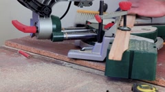 Workman sawing wood using a miter saw Stock Footage