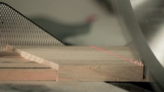 Hand-held belt sander at finished wood furniture Stock Footage