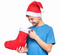 Teen boy wearing Santa Claus hat Stock Photos