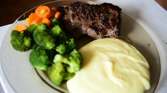 Plate with beef steak, mashed potatoes, carrots and broccoli Stock Footage