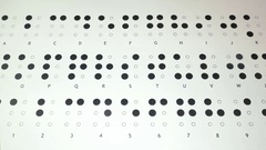 Footage of the Braille writing system alphabet, the shot is coming into focus Stock Footage