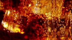 Cola background. Pouring Cola with Ice and bubbles in glass Stock Footage